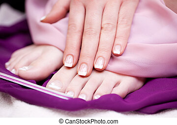 Glamorous manicured finger and toe nails - Woman displaying...
