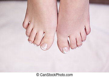 Manicured toenails - Overhead view of the bare feet of a...