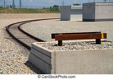 Railway deadlock - End of rail in an industrial area on...