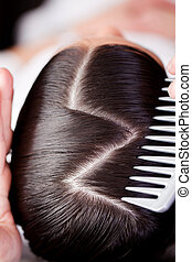 Creative hairstyle - Overhead view of the top of a brunette...