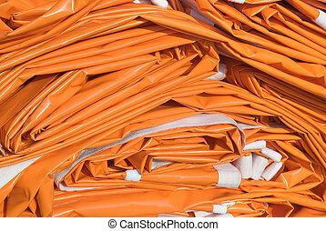 Folded Tarpaulin in Orange - Tarpaulin as Essential...