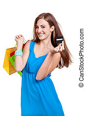 happy young woman with colorful shopping bags visa isolated...