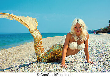 Beautiful blonde mermaid - Cute attractive blonde mermaid...