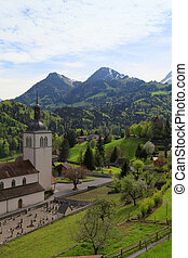 Church and Alps mountains, Gruyeres, Switzerland - Beautiful...