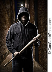 Thief on a dark alley - Thief in the hood on a dark alley