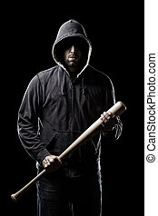 Thief in the hood on a black background