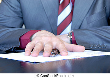 Business proposal - businessman hands on desk offers...