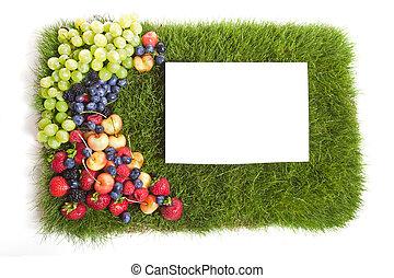 A grass mat with a fruit frame.