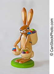 Easter decoration - cute easter bunny carrying baskets with...