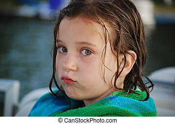 an after swim pout - a little girl pouts after a long day of...