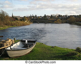 Rowing Boat - Picture of a rowboat on the shore of River...