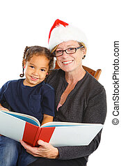 Christmas Storytime - a grandmother in her santa\\\'s hat...