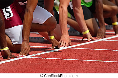 Starting line - a close up of runner\\\'s hands on the...