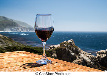 glass of wine ocean view - glass of wine close up on patio...