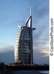 Burj Al Arab in Dubai - Hotel Burj Al Arab in Dubai at dusk,...