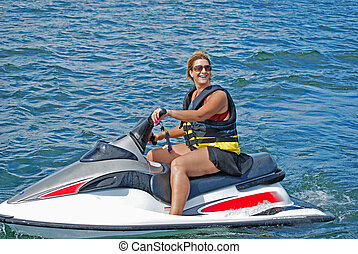 jet ski fun2 - a woman enjoys a hot summer day riding a...