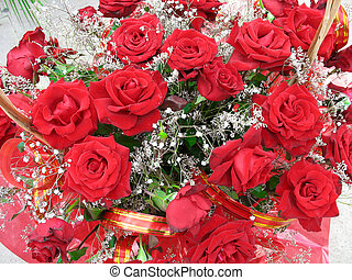 Bright red rose flowers with tapes composition background