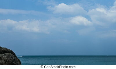 Seaside - Clouds drifting above the sea shore. Time-lapse