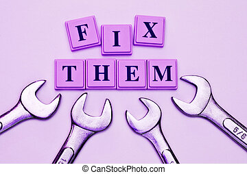 Fix Them spelled out in colored blocks