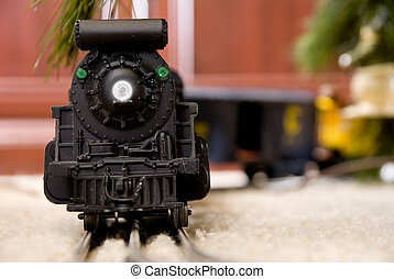 Christmas Train - A model train on a track under a Christmas...