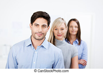 Businessman With Female Coworkers In Office - Portrait of...