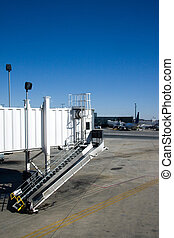 Airport Jet Way - An airport jetway awaits the arrival of an...