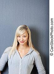 Confident Businesswoman Smiling Against Blue Wall - Portrait...