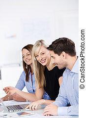 Businesswoman With Coworkers In A Meeting At Desk