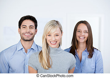 Business People Smiling Together In Office - Portrait of...