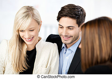 Couple in a meeting with an adviser - Stylish young couple...