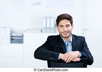 Young businessman - Portrait of young businessman sitting...