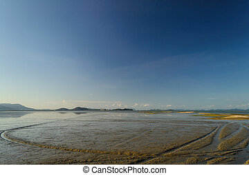 Eastcoast of phuket when low tide with blue sky