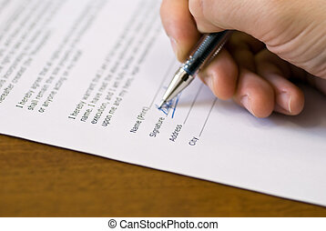 signature on agreement - Male hand make signature on an...