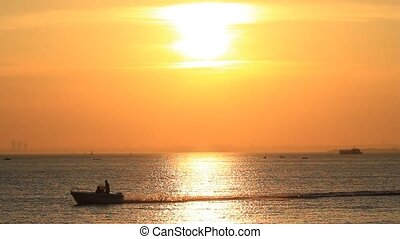 Boat speeds up at sunset - Power boat speeds up in Marmara...
