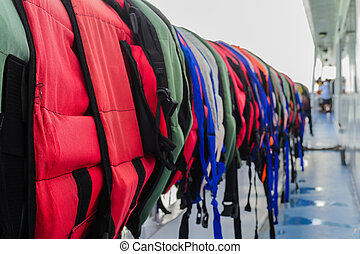 Lifejackets - Many of lifejacket are hanging on the cruise