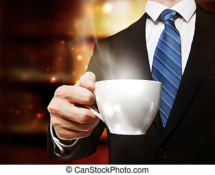 Business Man Holding a Cup of Coffee - Business man holding...