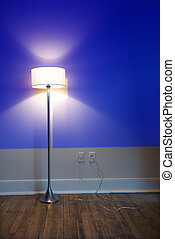 Lamp against blue wall.