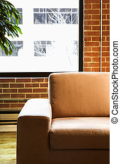 Chair in loft apartment. - Cushy chair in loft apartment...