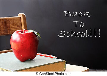 Back to School 2 - School books with apple sitting on a...