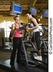 Woman with fitness trainer.