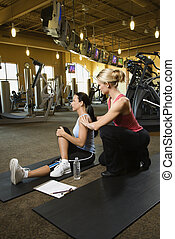 Woman with personal trainer - Prime adult Caucasian female...