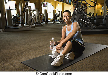 Woman at fitness gym.