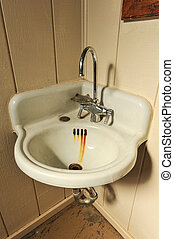 Old sink with rusty basin in corner - An old rusty sink with...