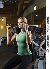 Woman working out at gym. - Prime adult Caucasian female...