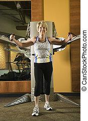Woman exercising. - Mature Caucasian adult female using...