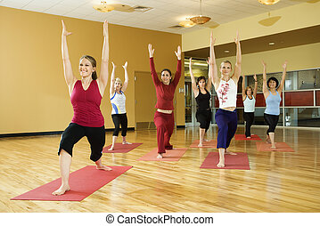 Women in yoga class - Prime adult female Caucasians in yoga...