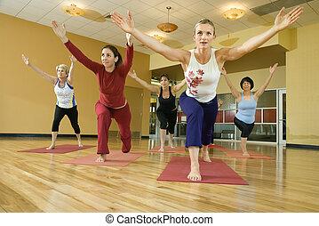 Women in yoga class. - Prime adult female Caucasians in yoga...