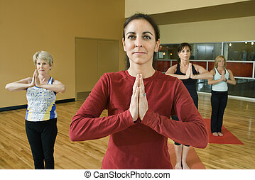 Women doing yoga - Prime adult female Caucasians in yoga...