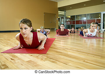 Women at health club - Prime adult female Caucasians in yoga...