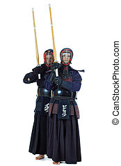 two fighters - Two kendo fighters posing together over white...